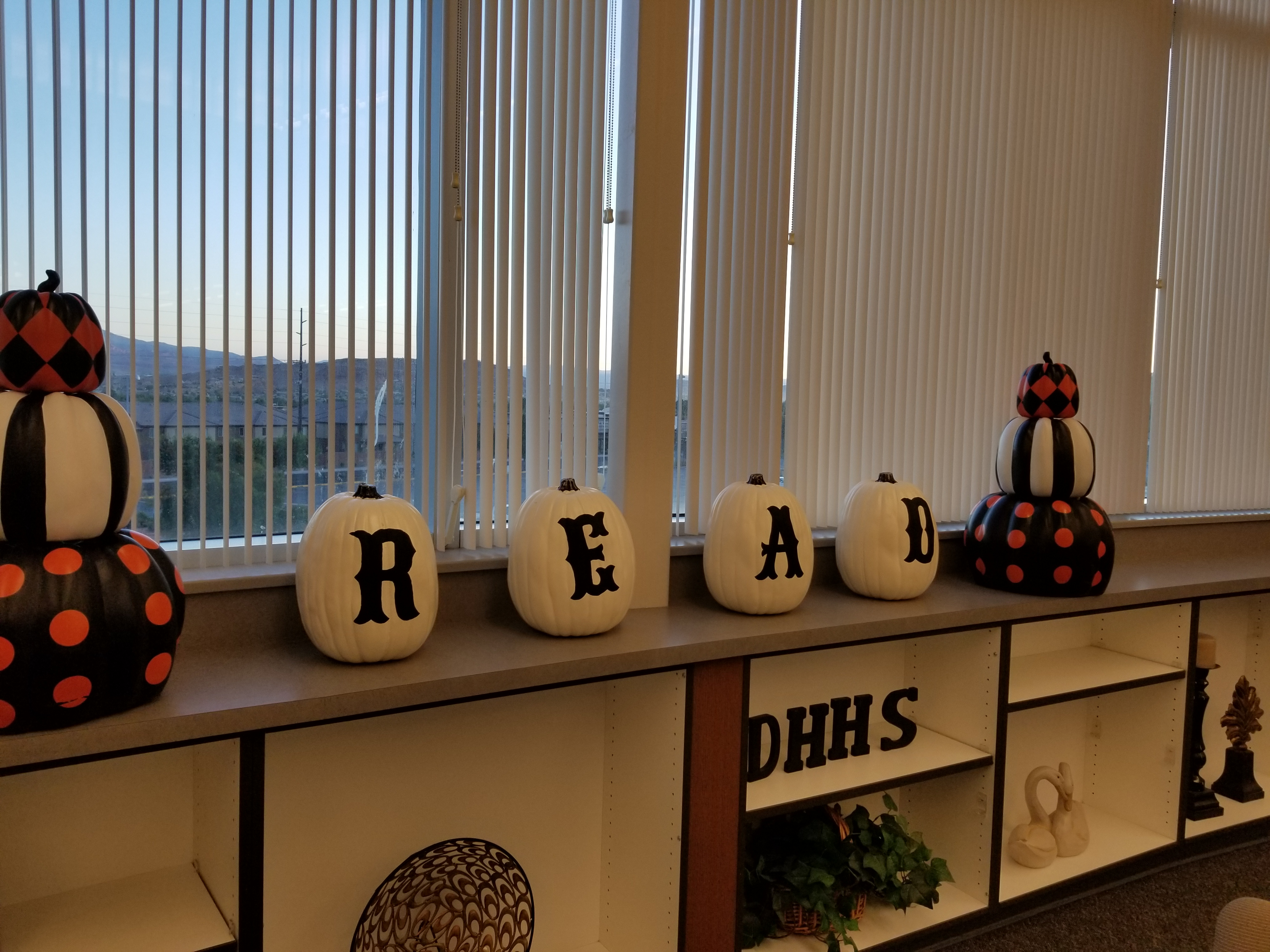 Decorative pumpkins displayed in library