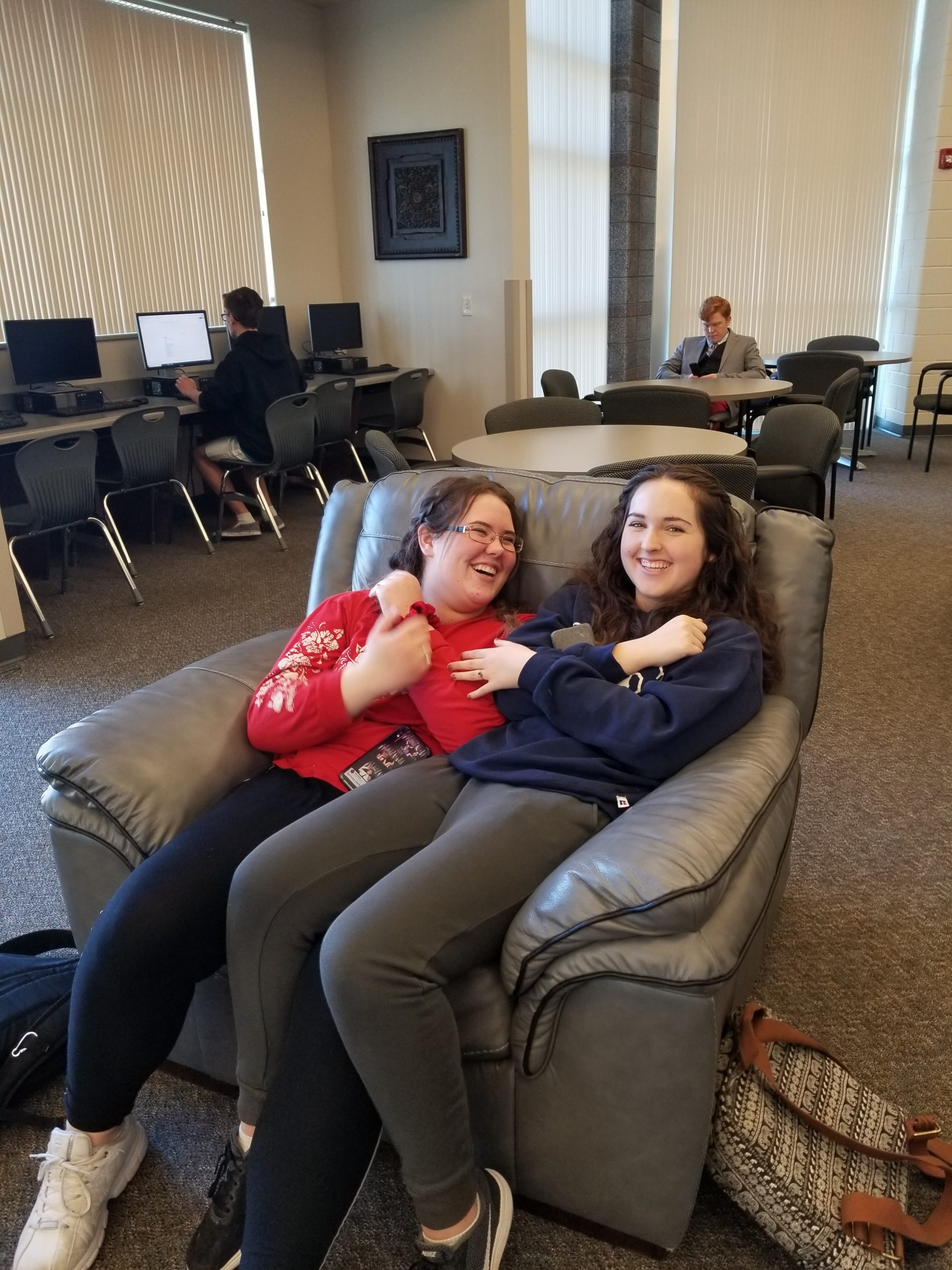 Students Hanging Out In Library