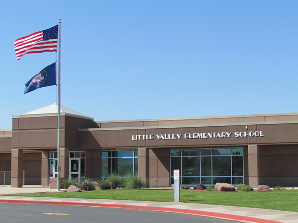 Little Valley Elementary Building with American and Utah Flags
